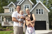 Happy Family In Front Of Their New House. [url=file_search.php?action=file&lightboxID=4800362][img]http://02b5b0c.netsolhost.com/stock/banniere4.jpg[/img][/url]